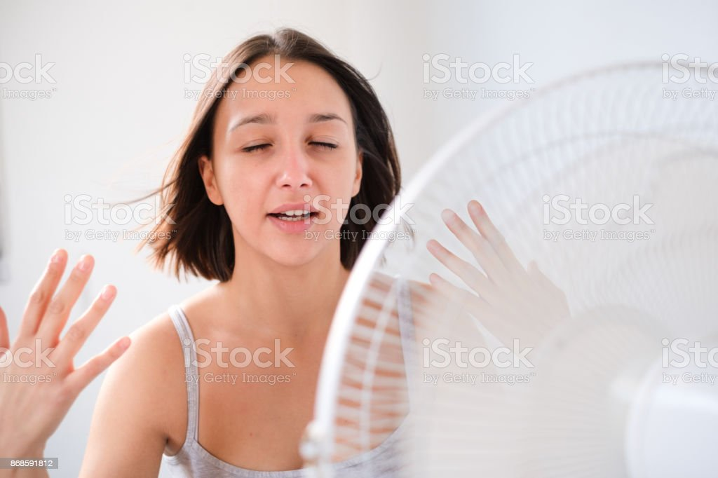 Young girl trying to refresh and cooling against summer haze stock photo
