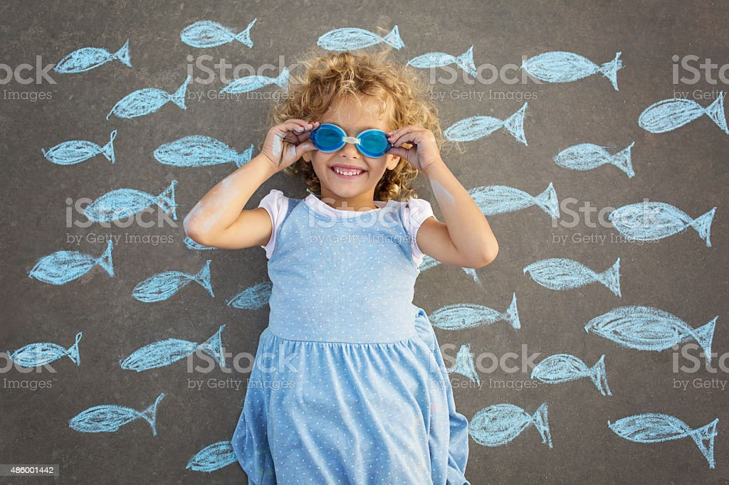Young girl underwater imagination stock photo