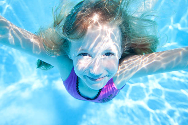 Young Girl Underwater stock photo