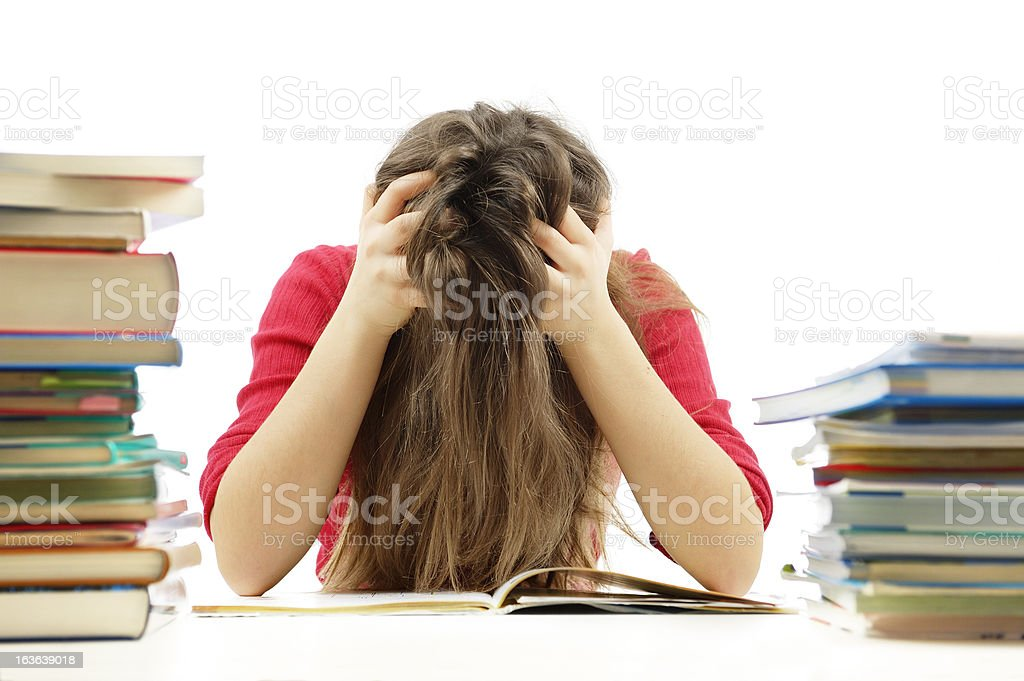 Young girl unhappy about homework royalty-free stock photo