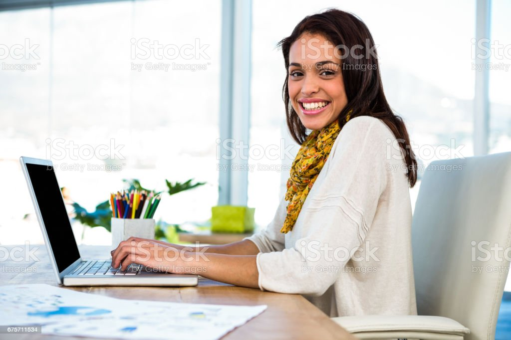 Young girl uses his computer royalty-free stock photo