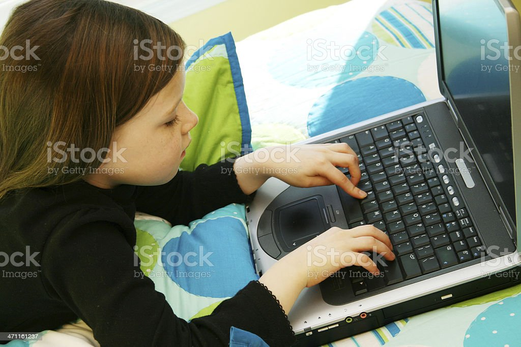 Young Girl Uses Laptop Computer royalty-free stock photo
