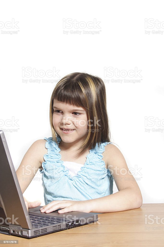 Young girl using notebook computer royalty-free stock photo