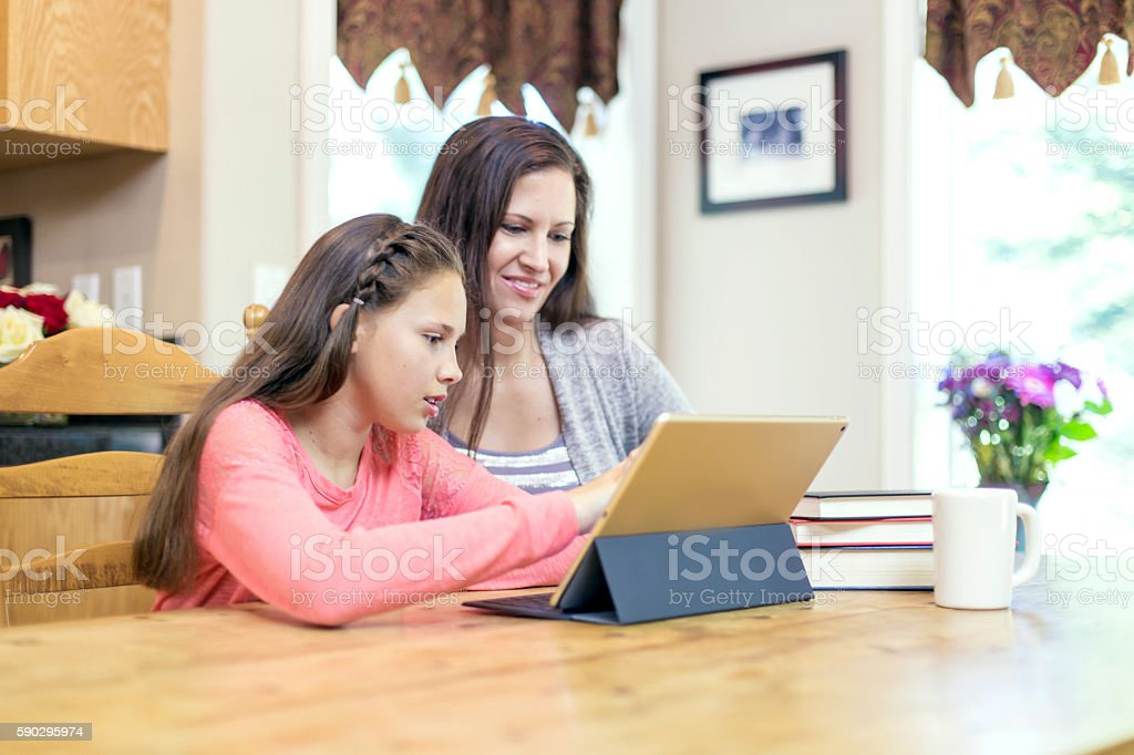 Young girl using tablet to learn royaltyfri bildbanksbilder