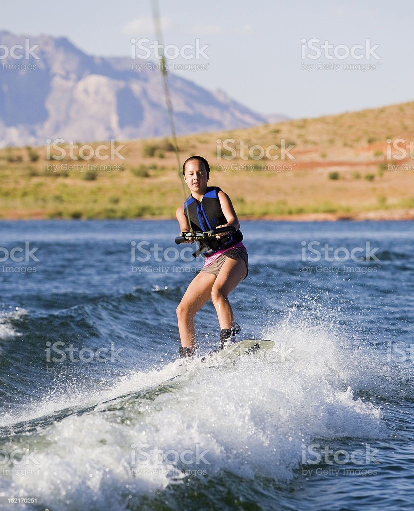 Young Girl wakeboarding at Lake Powell 02 royalty-free stock photo