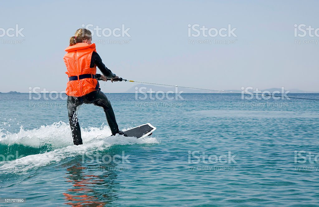 Young Girl Wakeboarding royalty-free stock photo