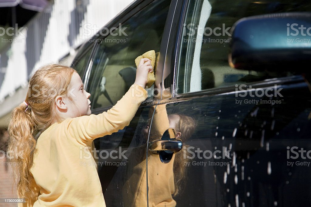 "Young girl washing a car ""Little 6 year old girl, busy with the weekly car wash job."" 6-7 Years Stock Photo"