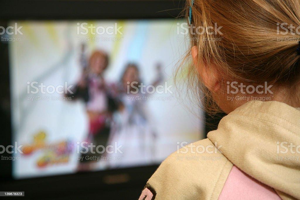 young girl watching TV stock photo