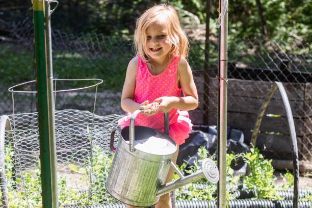 Young Girl Watering the Garden 2 – zdjęcie