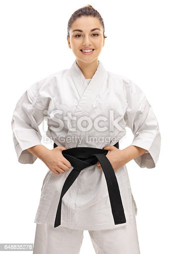 istock Young girl wearing a kimono with a black belt 648835278
