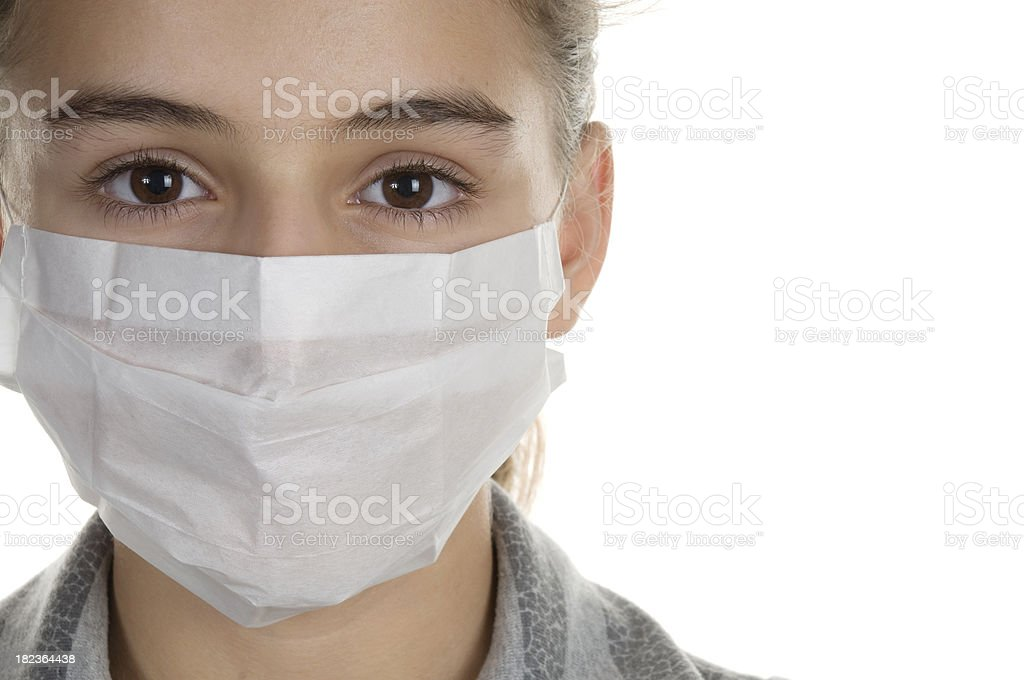 Young girl wearing a mask stock photo
