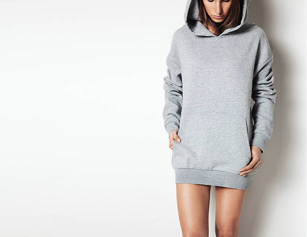 Young girl wearing blank and oversize long hoody. White background stock photo