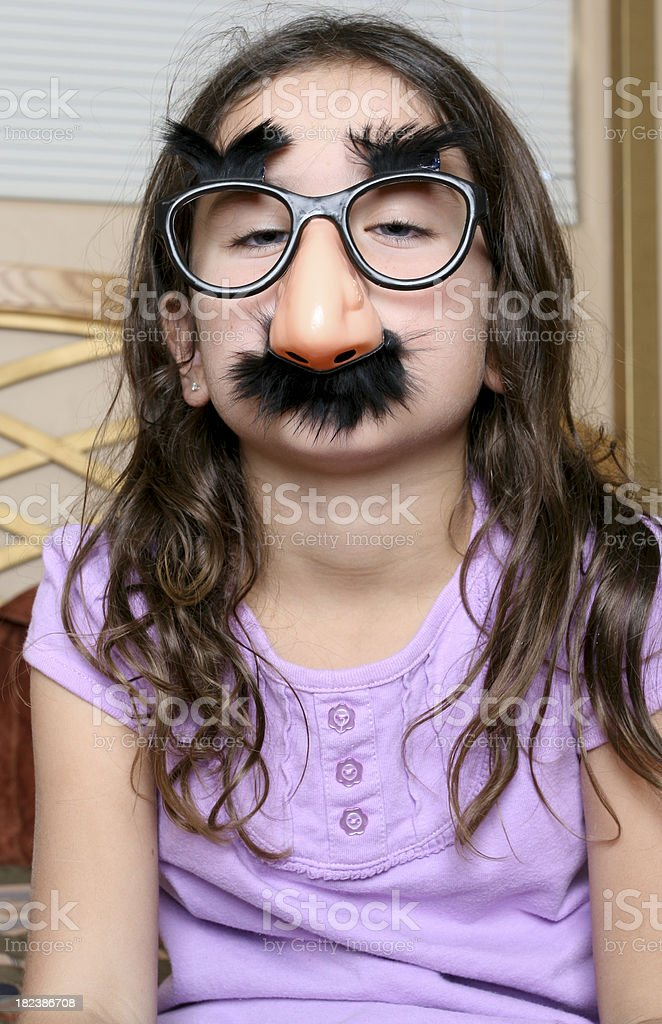Young Girl Wearing Funny Glasses stock photo