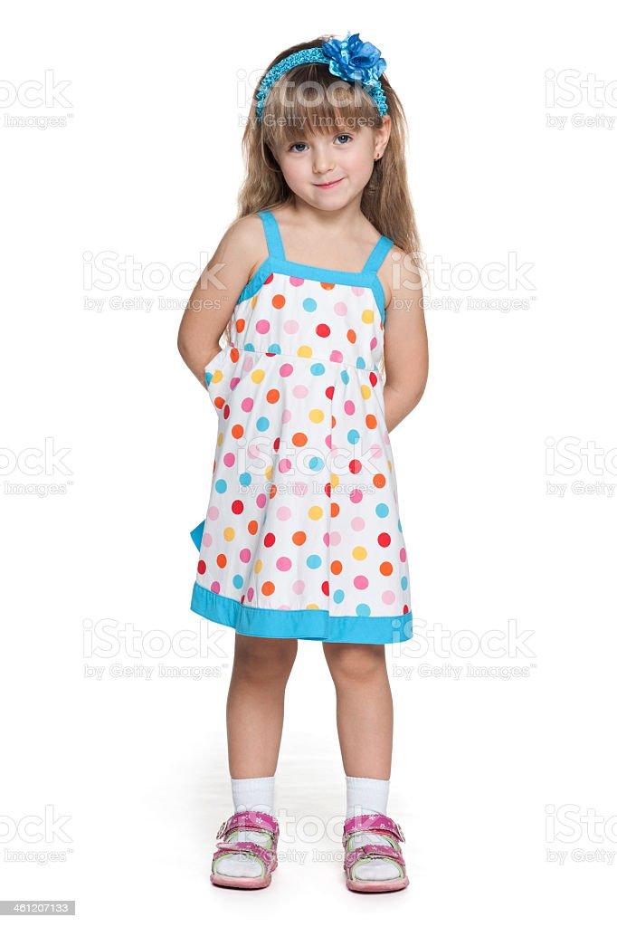 Young girl wearing polka dot dress stock photo