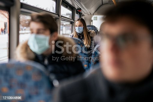 istock Young girl wearing sterile face mask using a public transport 1210644896