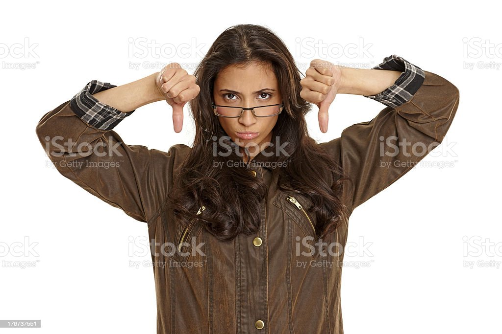 Young girl wearing warm coat showing thumbs down royalty-free stock photo