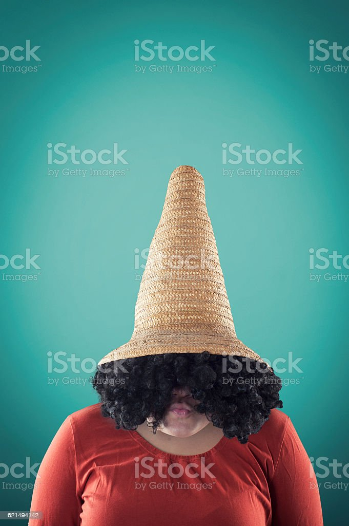 Young girl with a big straw hat photo libre de droits