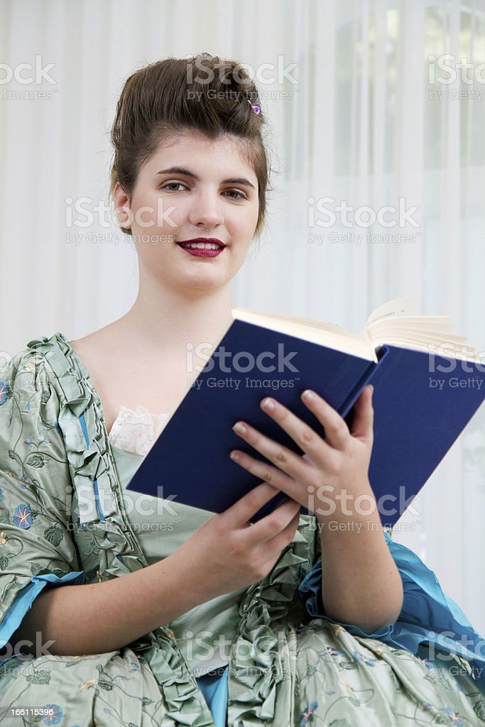 Young girl with a book royalty-free stock photo