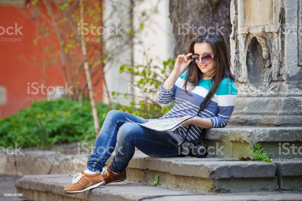young girl with a camera and map stock photo