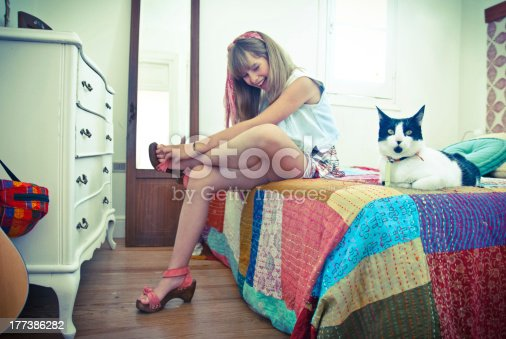 istock Young girl with a cat 177386282