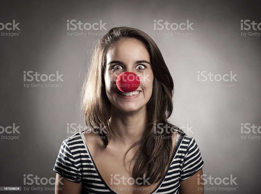 young girl with a clown nose stock photo