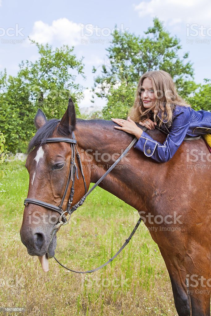 Young girl with a horse. royalty-free stock photo