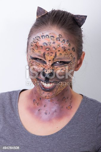 512061362 istock photo young girl with a leopard make up 494284508
