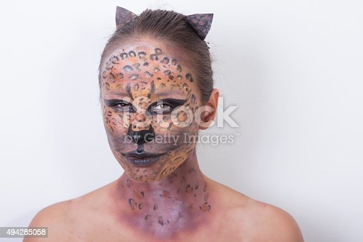 512061362 istock photo young girl with a leopard make up 494285058