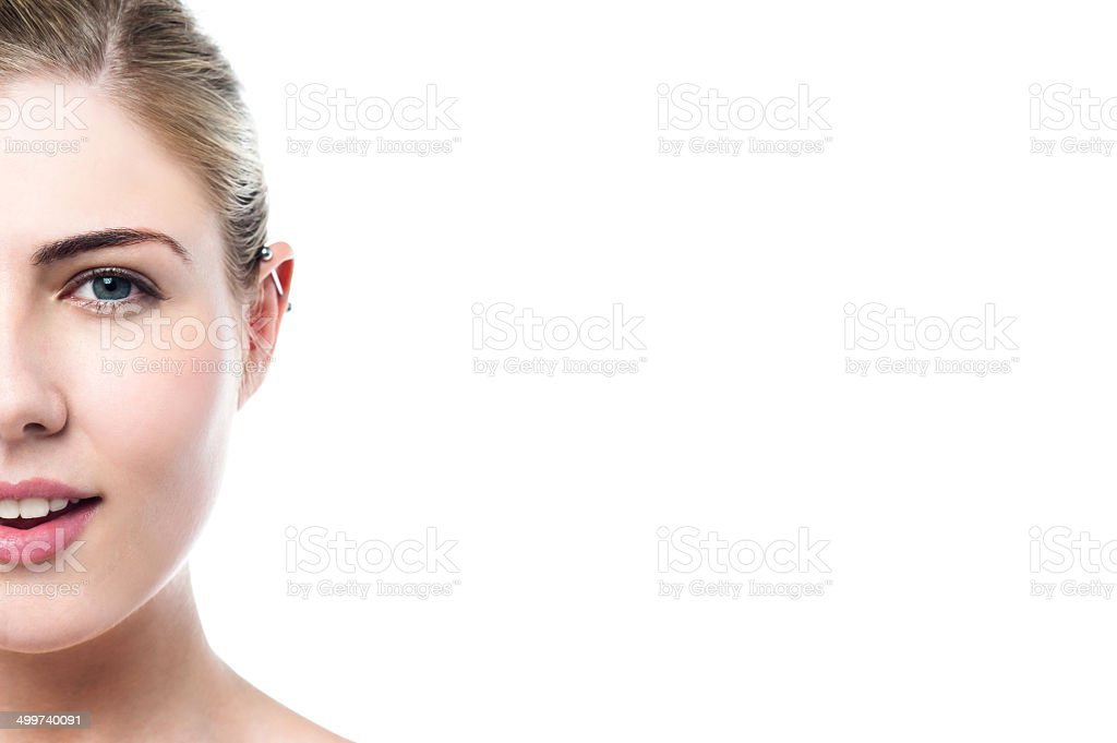 Young girl with a pierced ear stock photo