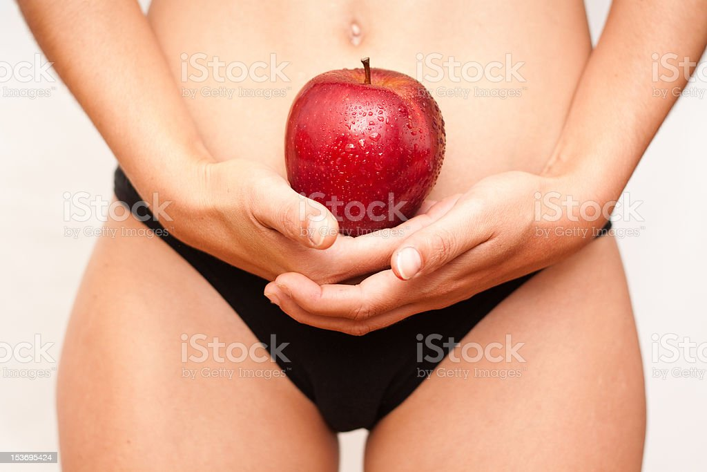 young girl with a red apple in her hand royalty-free stock photo