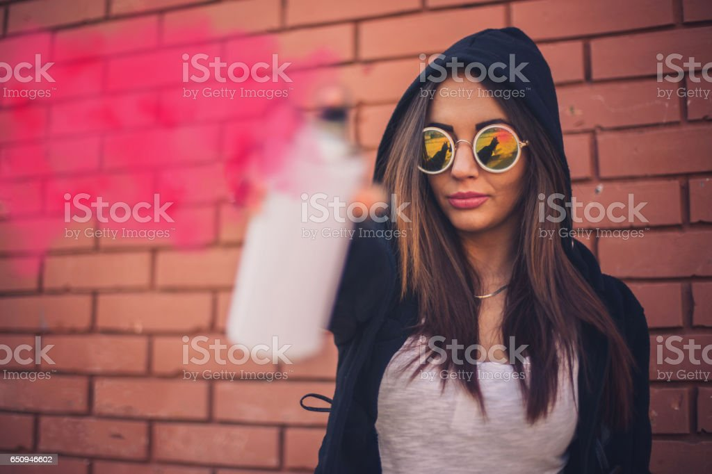 Young girl with a spray can stock photo