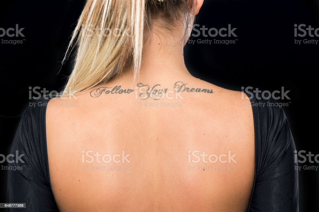 young girl with a tattoo stock photo