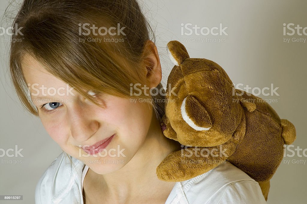 Young girl with a teddy bear royalty-free stock photo