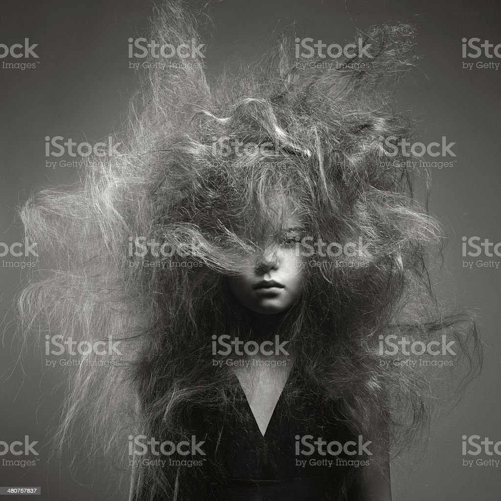 Young girl with a volume fashionable hairstyle stock photo