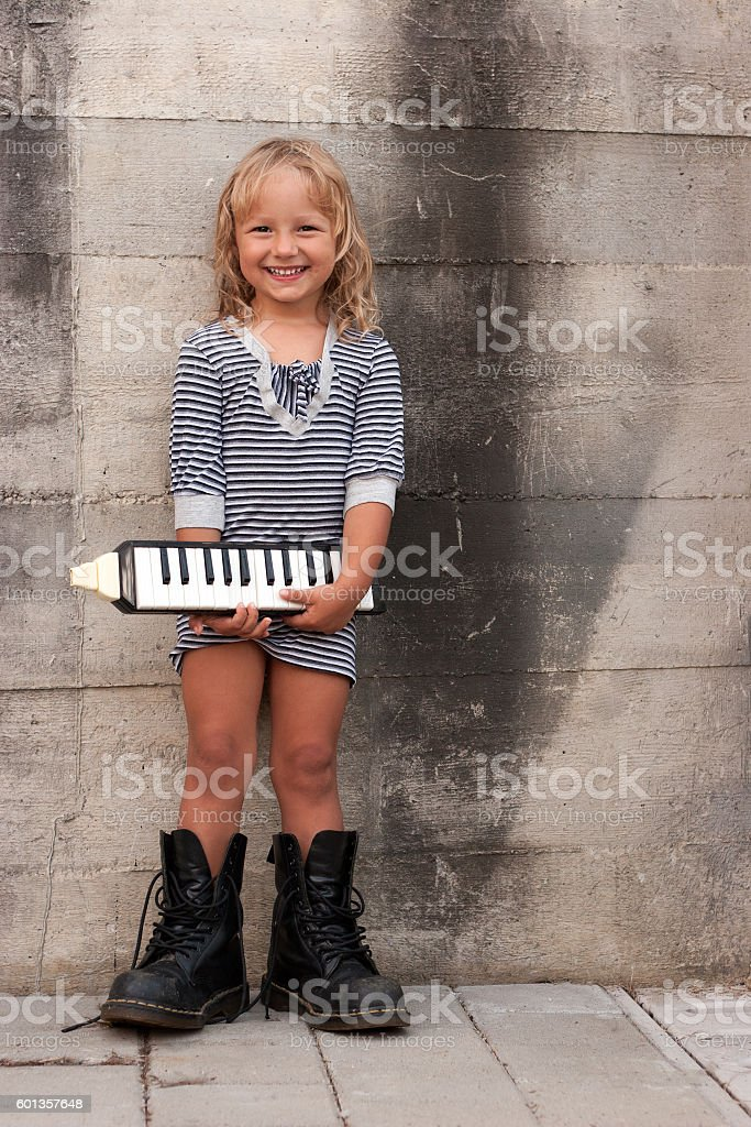 Young girl with an instrument stock photo
