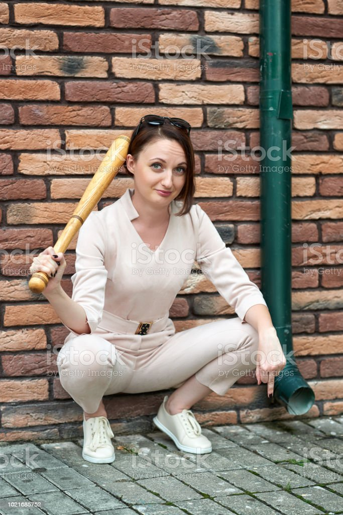 Young Girl With Baseball Bat Shows A Fuck Gesture And