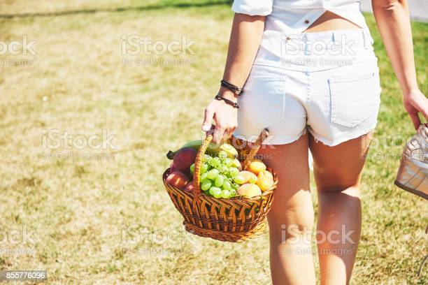 Young girl with basket going to have a picnic