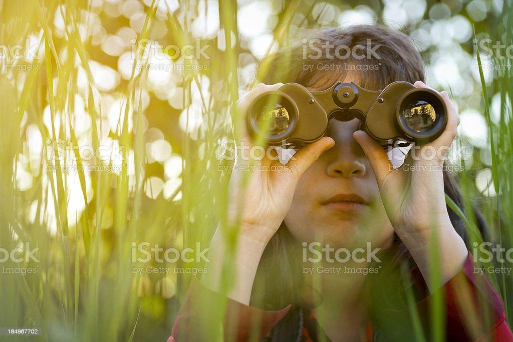 Young girl with binoculars stock photo