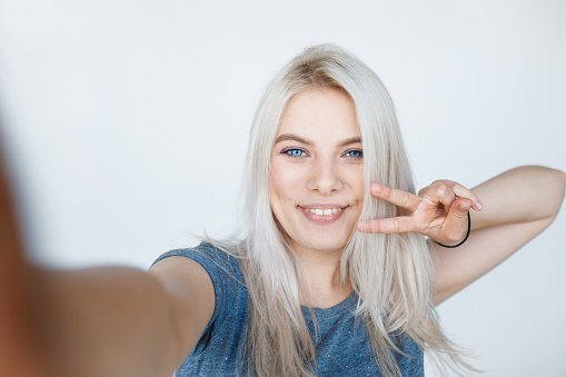 istock young girl with blond dyed hair smiling 625434868