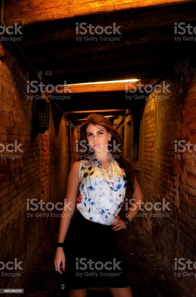 Young girl with blue skirt and flower shirt stock photo