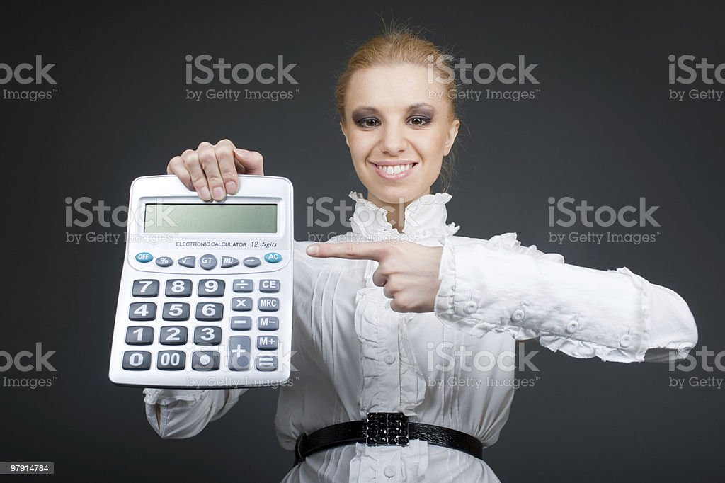 Young girl with calculator on grey royalty-free stock photo
