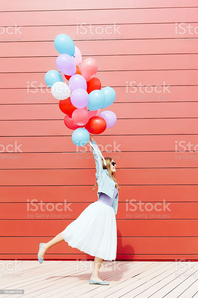 Young girl with colorful balloons stock photo