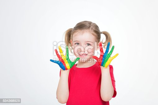 istock young girl with coloured hands 534368525