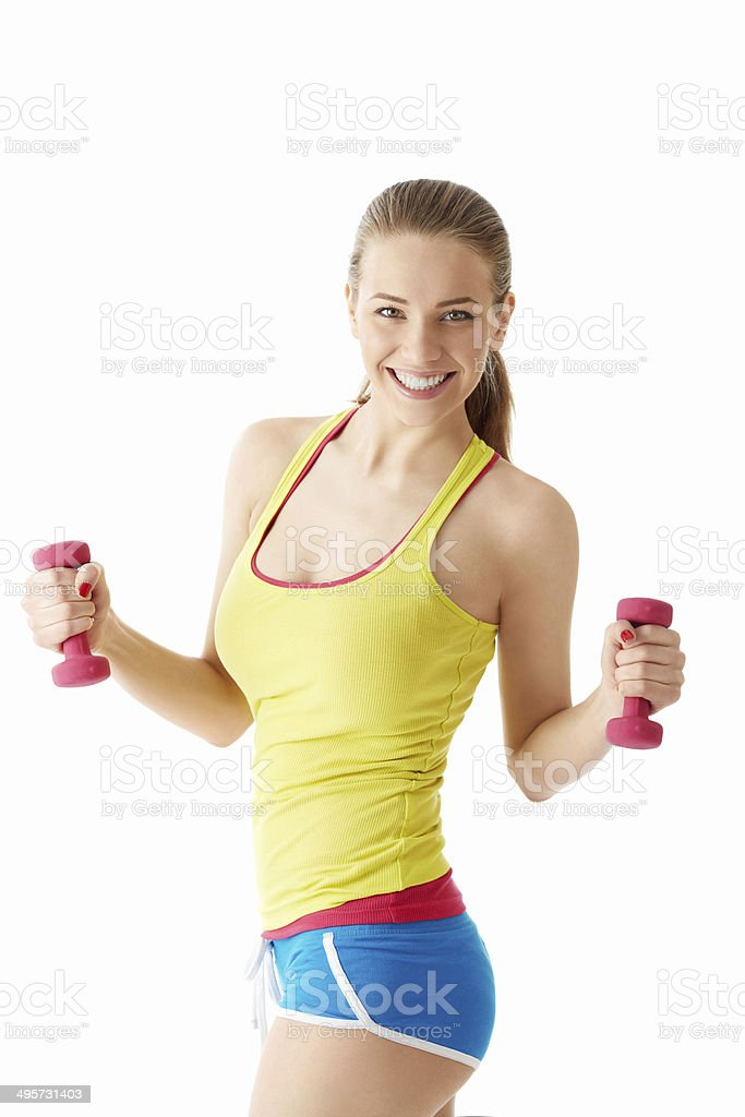Young girl with dumbbells stock photo