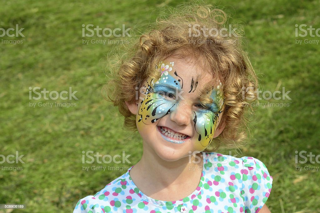 Young girl with face painted. stock photo