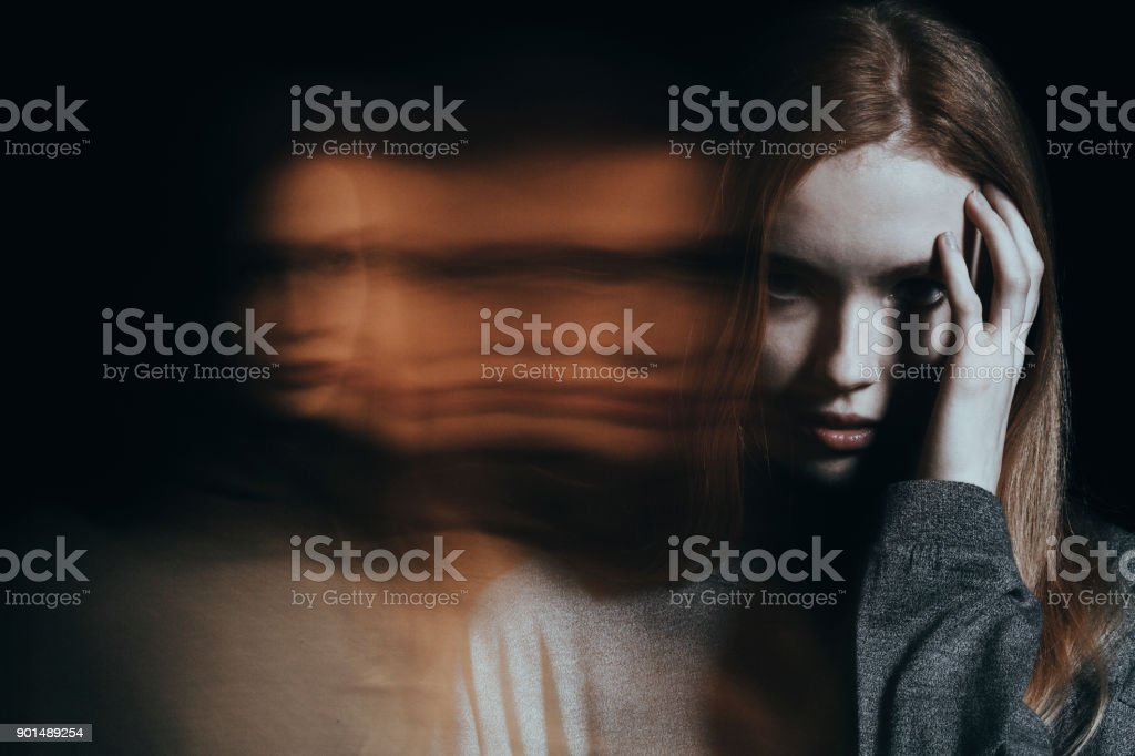 Young girl with hallucinations stock photo