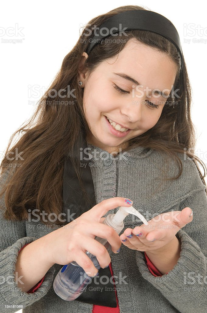 Young Girl with Hand Sanitizer stock photo