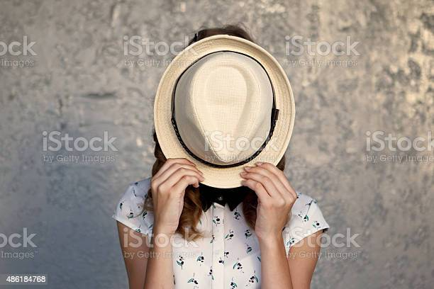 Young girl with hat hides her facedepression picture id486184768?b=1&k=6&m=486184768&s=612x612&h=dkwjehqntlkrlipbzjw3iudkhtxcj1jn7f l3kxa2ly=