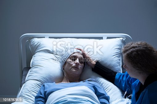910488904 istock photo Young girl with ill woman 1018787978