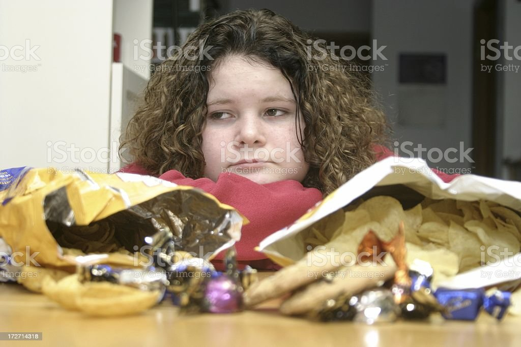 Young Girl with Junk Food royalty-free stock photo
